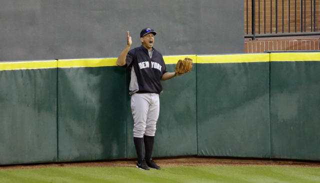New York Yankee's Alex Rodriguez yells to teammates while standing on Tal's Hill in center field before a baseball game against the Houston Astros Saturday, Sept. 28, 2013, in Houston. (AP Photo/David J. Phillip)