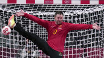 <p>Sweden's goalkeeper Andreas Palicka tries to make a save during the men's Preliminary Round Group B handball match between Sweden and Portugal at the 2020 Summer Olympics, Wednesday, July 28, 2021, in Tokyo, Japan. (AP Photo/Pavel Golovkin)</p>