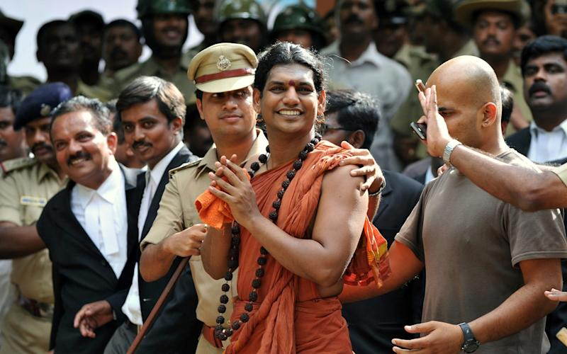 Hindu 'godman' Swami Nityananda faces a series of sexual assault charges in India - AFP