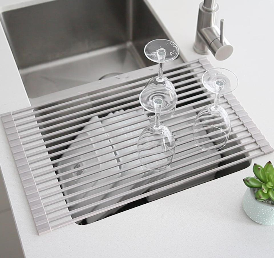 "<p>This <a href=""https://www.popsugar.com/buy/Stainless-Steel-Collapsible-Over-Sink-Dish-Rack-579045?p_name=Stainless%20Steel%20Collapsible%20Over%20the%20Sink%20Dish%20Rack&retailer=wayfair.com&pid=579045&price=42&evar1=casa%3Aus&evar9=47575922&evar98=https%3A%2F%2Fwww.popsugar.com%2Fhome%2Fphoto-gallery%2F47575922%2Fimage%2F47575959%2FStainless-Steel-Collapsible-Over-Sink-Dish-Rack&list1=gadgets%2Ckitchens%2Chome%20shopping&prop13=mobile&pdata=1"" class=""link rapid-noclick-resp"" rel=""nofollow noopener"" target=""_blank"" data-ylk=""slk:Stainless Steel Collapsible Over the Sink Dish Rack"">Stainless Steel Collapsible Over the Sink Dish Rack</a> ($42, originally $70) will keep your countertop clean.</p>"
