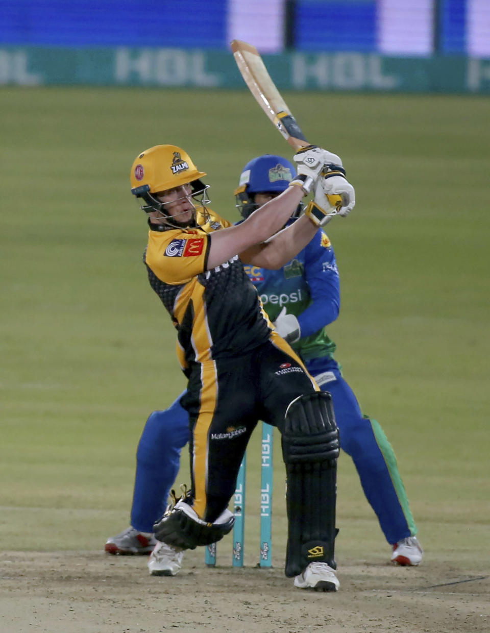 Peshawar Zalmi Tom Kohler Cadmore follows the ball after playing a shot for boundary during a Pakistan Super League T20 cricket match between Multan Sultans and Peshawar Zalmi at the National Stadium, in Karachi, Pakistan, Tuesday, Feb. 23, 2021. (AP Photo/Fareed Khan)