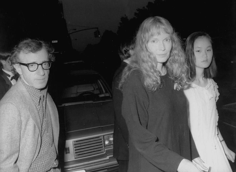 Actors Woody Allen and Mia Farrow w. her adopted daughter Soon-Yi leaving Farrow's apartment to see Liza Minnelli at Carnegie Hall.  (Photo by Time Life Pictures/DMI/The LIFE Picture Collection via Getty Images)