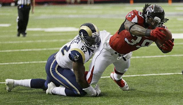 Atlanta Falcons running back Steven Jackson (39) runs into the end zone as St. Louis Rams linebacker Alec Ogletree (52) defends during the first half of an NFL football game, Sunday, Sept. 15, 2013, in Atlanta. (AP Photo/John Bazemore)