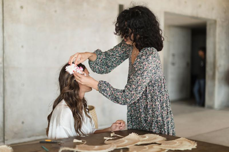 April Valencia putting Caroline's flower in her hair before the wedding.
