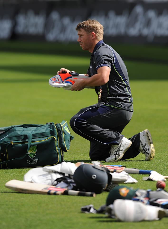 LONDON, ENGLAND - AUGUST 19: David Warner of Australia takes his pads off during an Australian Nets Session at The Kia Oval on August 19, 2013 in London, England.  (Photo by Steve Bardens/Getty Images)