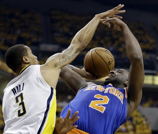 New York Knicks' Raymond Felton (2) tries to shoot past Indiana Pacers' George Hill (3) during the first half of Game 3 of an Eastern Conference semifinal NBA basketball playoff series in Saturday, May 11, 2013, in Indianapolis. (AP Photo/Darron Cummings)