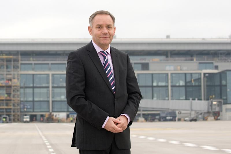 FILE - In this Jan. 25, 2012 file picture, the chief executive of Berlin's airports Rainer Schwarz, stands at Schoenefeld airport, Berlin. The chief executive of Berlin's airports has been fired following a decision to delay yet again the opening of the German capital's new airport - a fiasco that has deeply embarrassed local officials. The chairman of the airport operator's supervisory board, Brandenburg state governor Matthias Platzeck, said after directors met Wednesday Jan. 16, 2013 that CEO Rainer Schwarz had left the company. Officials said last week they wouldn't be able to open the new airport, just outside Berlin, on Oct. 27 - the fourth delay as builders struggle with technical problems. (AP Photo/dapd/ Klaus-Dietmar Gabbert,File)