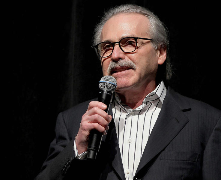 FILE - In this Jan. 31, 2014 photo, David Pecker, chairman and CEO of American Media, addresses those attending the Shape & Men's Fitness Super Bowl Party in New York. American Media announced Thursday, April 18, 2019, that it is selling the supermarket weekly National Enquirer to James Cohen, the former head of the airport newsstand company Hudson News. (Marion Curtis via AP, File)