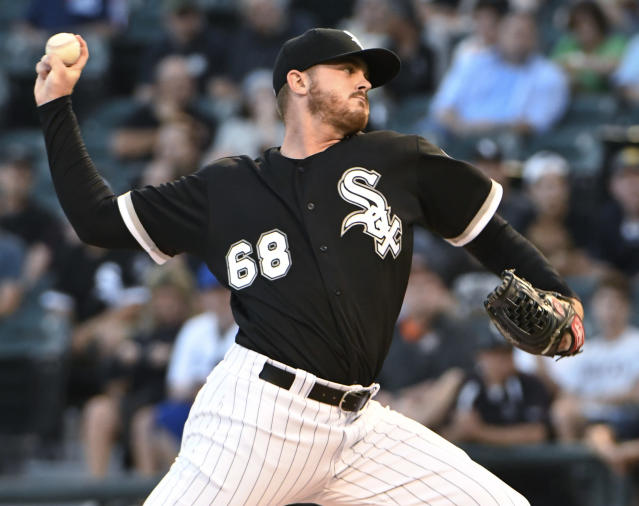 Chicago White Sox starting pitcher Dylan Covey throws to a Kansas City Royals batter during the first inning of a baseball game Wednesday, Aug. 1, 2018, in Chicago. (AP Photo/David Banks)