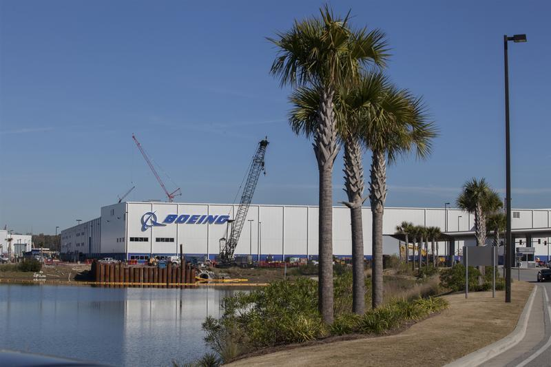 Construction cranes and palm trees line the entrance at South Carolina Boeing in North Charleston