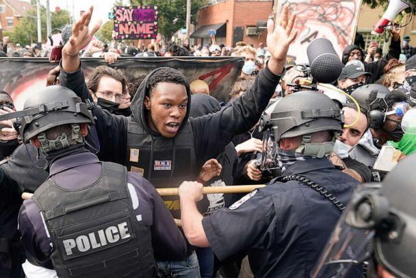 PHOTO: A protester clashes with police after a grand jury considering the March killing of Breonna Taylor in her home, voted to indict one of three white police officers for wanton endangerment, in Louisville, Ky., Sept. 23, 2020. (Bryan Woolston/Reuters, FILE)