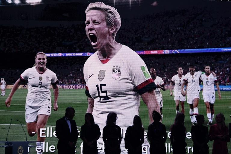 Megan Rapinoe appeared on screen at the Ballon d'Or awards ceremony having been unable to travel to Paris to claim her prize (AFP Photo/FRANCK FIFE)