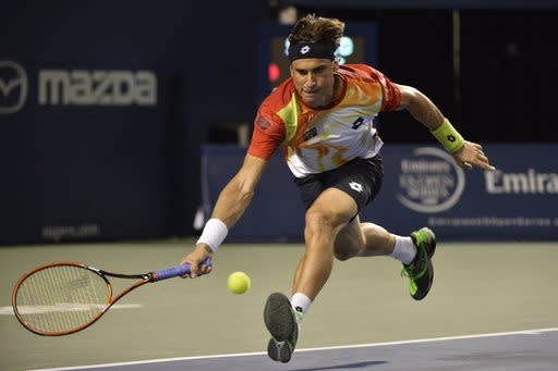 David Ferrer, of Spain, returns to Roger Federer, of Switzerland, at the Rogers Cup tennis tournament, Friday, Aug. 8, 2014 in Toronto. (AP Photo/The Canadian Press, Nathan Denette)