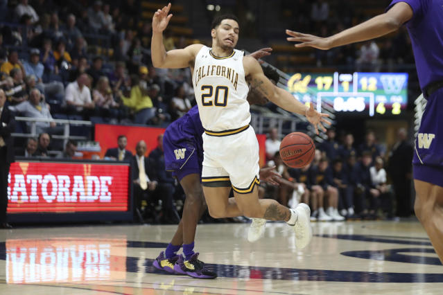 California guard Matt Bradley (20) is fouled by Washington guard Elijah Hardy during the first half of an NCAA college basketball game in Berkeley, Calif., Saturday, Jan. 11, 2020. (AP Photo/Jed Jacobsohn)