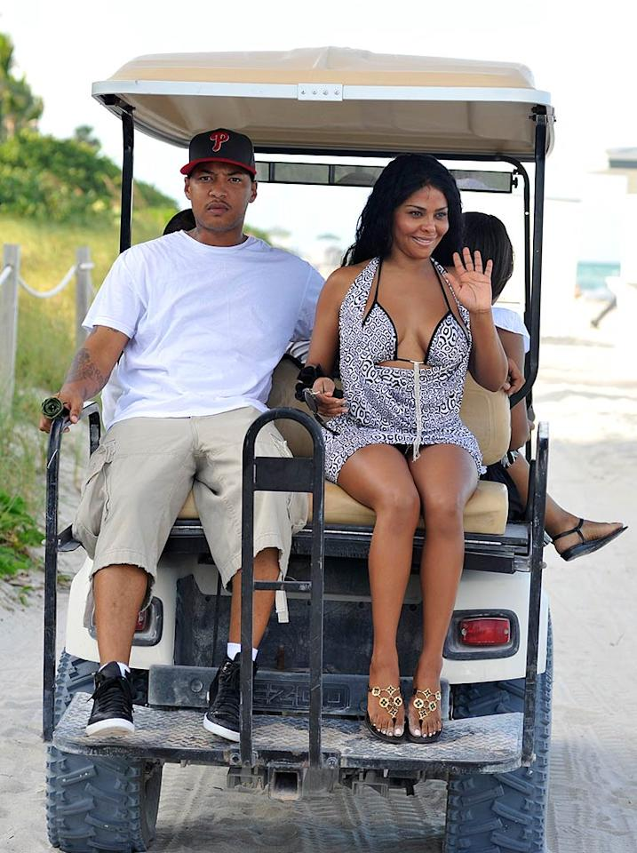 "Lil' Kim drives off into the sunset with her date ... or is that her bodyguard? <a href=""http://www.infdaily.com"" target=""new"">INFDaily.com</a> - September 22, 2009"
