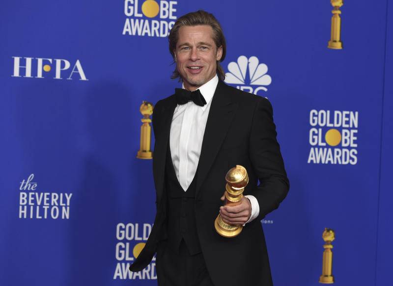"Brad Pitt poses in the press room with the award for best performance by an actor in a supporting role in any motion picture for ""Once Upon a Time...in Hollywood"" at the 77th annual Golden Globe Awards at the Beverly Hilton Hotel on Sunday, Jan. 5, 2020, in Beverly Hills, Calif. (AP Photo/Chris Pizzello)"