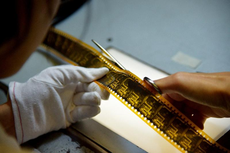 An employee of film restoration laboratory Cineteca di Bologna works on the restoration of a film at the laboratory in Bologna, northern Italy on June 25, 2015 (AFP Photo/Vincenzo Pinto)