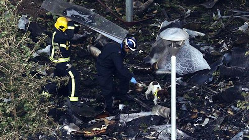 Firefighters search through the rubble in the inferno's aftermath. Source: Getty Images
