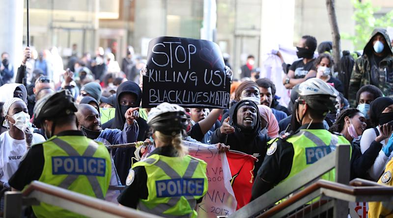 Activists and protesters rally in front of Toronto police headquarters on May 30, 2020 after the death of 29-year-old Regis Korchinski-Paquet. (Photo: Steve Russell via Getty Images)