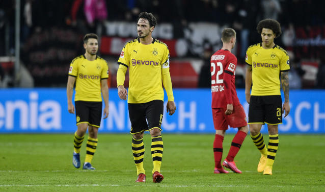 Dortmund's disappointed captain Mats Hummels walks to his fans after the German Bundesliga soccer match between Bayer Leverkusen and Borussia Dortmund in Leverkusen, Germany, Saturday, Feb. 8, 2020. Leverkusen defeated Dortmund with 4-3. (AP Photo/Martin Meissner)