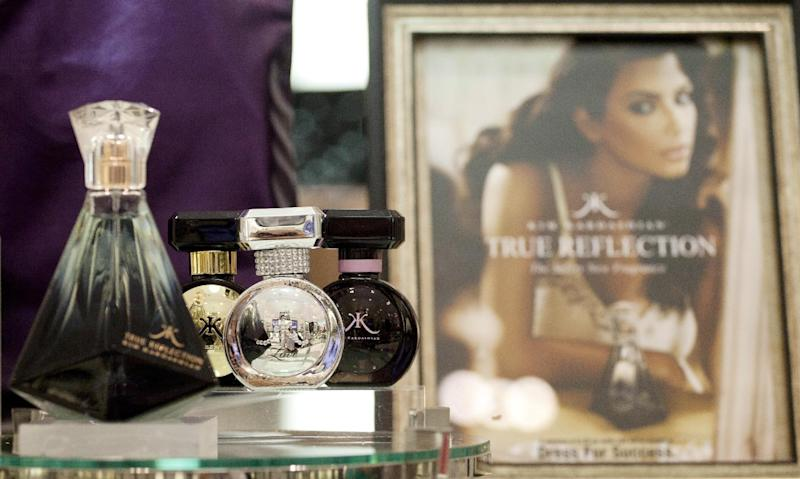 In this Aug. 23, 2012, photo, fragrances from the Kim Kardashian collection are displayed at a Lord & Taylor department store in New York. Celebrities have long dabbled in design, but with the growth of TV shows and websites that follow everything celebrities say, wear and do, interest in their clothing lines has risen in recent years. North America revenue from celebrity clothing lines, excluding merchandise linked to athletes, rose 6 percent last year to an historic peak of $7.58 billion in 2011, according to the latest figures available by The Licensing Letter, an industry trade. That's on top of a nearly 5 percent increase in 2010. (AP Photo/Mark Lennihan)