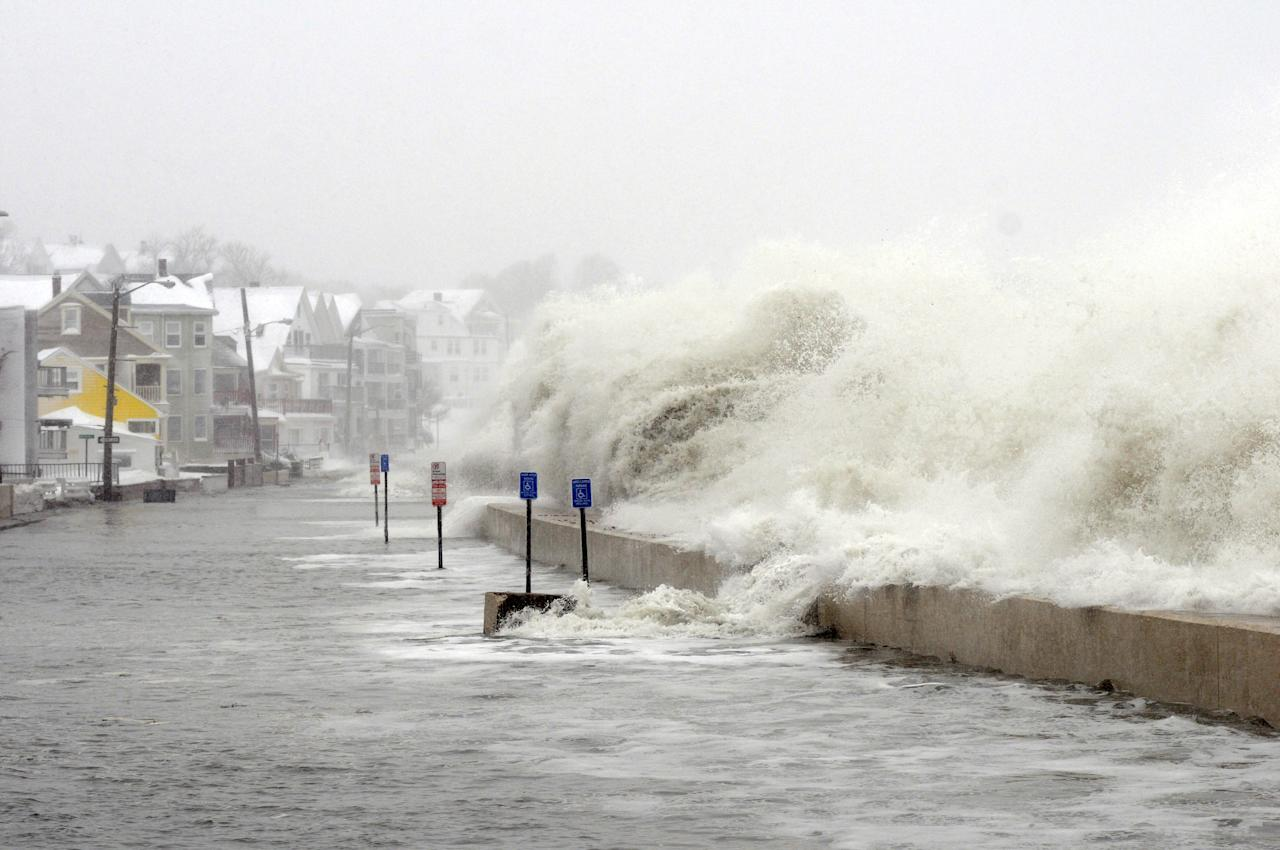 WINTHROP, MA - FEBRUARY 09: The ocean overflows the sea wall on Winthrop Shore Drive February 9, 2013 in Winthrop, Massachusetts. An overnight blizzard left one to two feet of snow in areas, and coastal flooding is expected as the storm lingers into the day. (Photo by Darren McCollester/Getty Images)