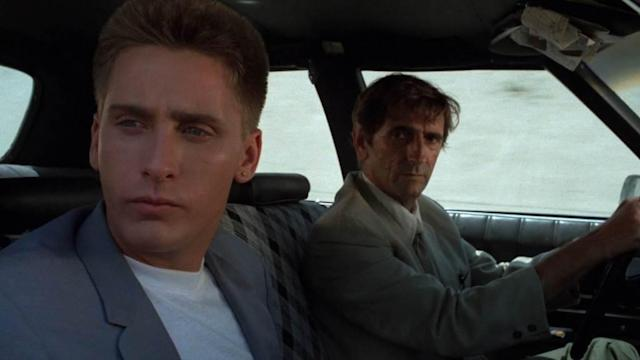 <p>Stanton plays the repo man, Bud, who recruits and mentors Emilio Estevez in the bonkers sci-fi cult classic.<br><br>(Photo: Universal Pictures/courtesy Everett Collection) </p>