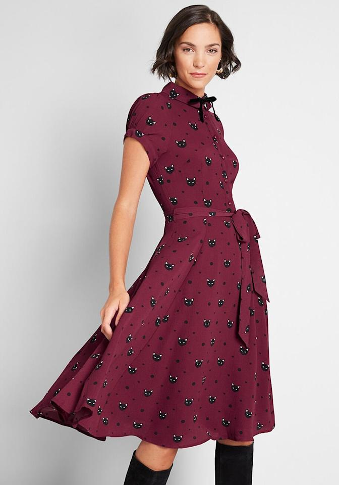 "<p>Wear this <a href=""https://www.popsugar.com/buy/Miss-Meow-Midi-Dress-497347?p_name=Miss%20Meow%20Midi%20Dress&retailer=modcloth.com&pid=497347&price=89&evar1=tres%3Aus&evar9=46709556&evar98=https%3A%2F%2Fwww.popsugar.com%2Fphoto-gallery%2F46709556%2Fimage%2F46709708%2FMiss-Meow-Midi-Dress&list1=shopping%2Challoween%2Cmodcloth&prop13=api&pdata=1"" rel=""nofollow"" data-shoppable-link=""1"" target=""_blank"" class=""ga-track"" data-ga-category=""Related"" data-ga-label=""https://www.modcloth.com/shop/dresses/collectif-miss-meow-midi-dress-in-red/166645.html"" data-ga-action=""In-Line Links"">Miss Meow Midi Dress</a> ($89) with black tights.</p>"