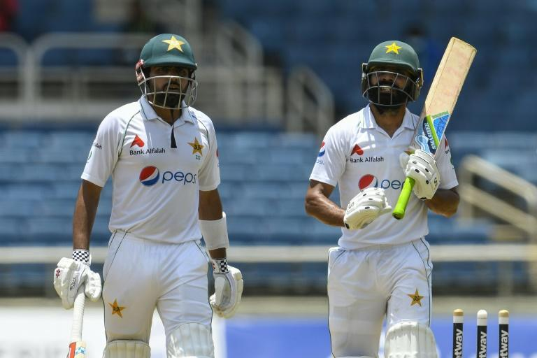 To the rescue: Babar Azam (left) and Fawad Alam walk off at lunch