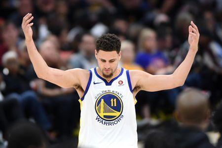 FILE PHOTO: Jun 8, 2018; Cleveland, OH, USA; Golden State Warriors guard Klay Thompson (11) reacts during the third quarter in game four of the 2018 NBA Finals against the Cleveland Cavaliers at Quicken Loans Arena. Ken Blaze-USA TODAY Sports