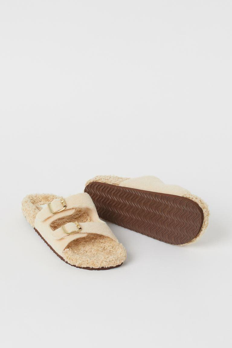 <p>These <span>Faux Shearling-lined Slippers</span> ($30) were made to keep your feet snug and cozy.</p>