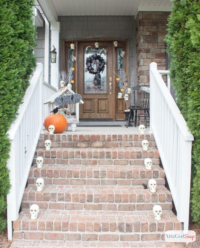 "<p>Line your front steps (or walkway) with skulls. If you want something a little more colorful (and less spooky), paint them into sugar skulls!</p><p>See more at <a href=""https://www.attagirlsays.com/scary-halloween-decorations-for-the-front-porch/"" rel=""nofollow noopener"" target=""_blank"" data-ylk=""slk:Atta Girl Says"" class=""link rapid-noclick-resp"">Atta Girl Says</a>.</p>"