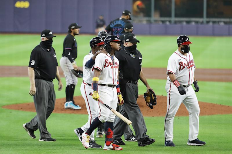 Ronald Acuna Jr. reacts after being hit by a Sandy Alcantara pitch during Game 1 of the NLDS. (Photo by Bob Levey/Getty Images)