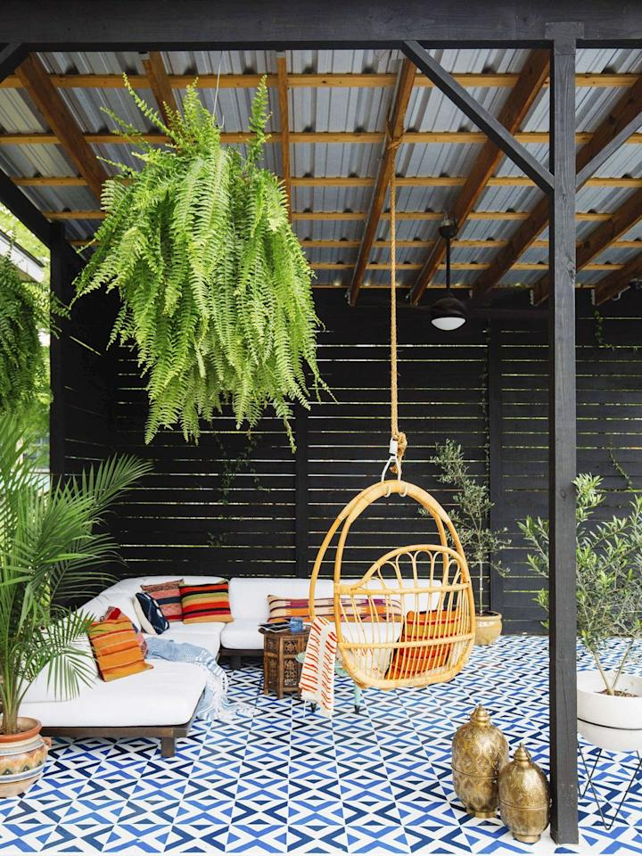 "<p>Turning an empty backyard corner into paradise is easier than you may think. A colorful rug, a floating couch, and plants pull together a space, but it'll be a porch swing that steals the show.</p><p><a class=""body-btn-link"" href=""https://www.amazon.com/Sorbus-Hammock-Macrame-Capacity-Perfect/dp/B074NBLVSS/?tag=syn-yahoo-20&ascsubtag=%5Bartid%7C10072.g.28195536%5Bsrc%7Cyahoo-us"" target=""_blank"">SHOP PORCH SWINGS</a></p>"