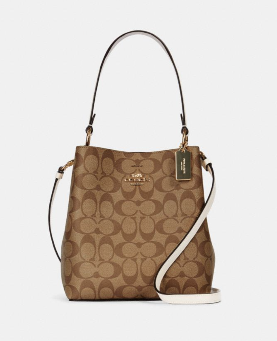 Small Town Bucket Bag in Signature Canvas in Khaki Chalk (Photo via Coach Outlet)