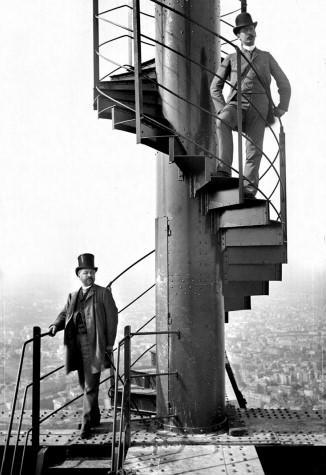 Gustave Eiffel and his collaborator M. Salles, on his tower's staircase, in 1889.
