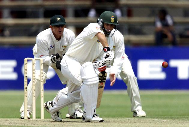 7 Sep 2001:  Gary Kirsten plays a defensive shot as Zimbabwe keeper Andy Flower looks on during the First Test between South Africa v Zimbabwe in Harare, Zimbabwe.  DIGITAL IMAGE   Mandatory Credit: Touchline Photo/ALLSPORT