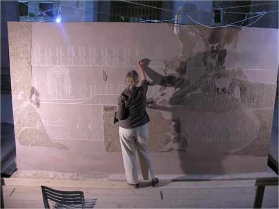 Archaeologist Lyla Pinch Brock at work reconstructing a giant outer sarcophagus box belonging to Egyptian pharaoh Merneptah.
