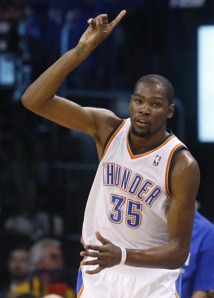 Oklahoma City Thunder forward Kevin Durant (35) gestures after hitting a three-point basket in the first quarter of Game 2 of the Western Conference semifinal NBA basketball playoff series against the Los Angeles Clippers in Oklahoma City, Wednesday, May 7, 2014. (AP Photo/Sue Ogrocki)