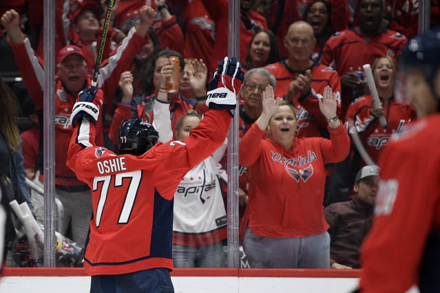 Washington Capitals right wing T.J. Oshie (77) celebrates his goal during the second period of an NHL hockey game against the Carolina Hurricanes, Saturday, Oct. 5, 2019, in Washington. (AP Photo/Nick Wass)