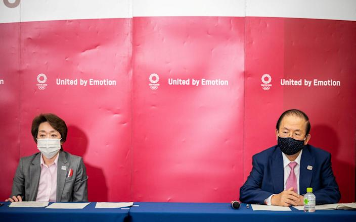 Tokyo 2020 President Seiko Hashimoto and CEO Toshiro Muto attend a news conference - Philip Fong