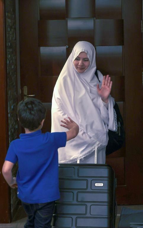 Bushra, 38, waves goodbye to her son after the Saudi hajj ministry lifted restrictions on women under the age of 45 travelling alone