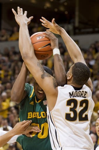 Baylor's Quincy Miller, left, fights his way past Missouri's Steve Moore, right, as he tries to shoot during the first half of an NCAA college basketball game, Saturday, Feb. 11, 2012, in Columbia, Mo. (AP Photo/L.G. Patterson)