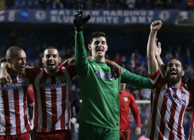 Members of the Atletico Madrid team celebrate in front of their fans after defeating Chelsea in the Champions League semifinal second leg soccer match between Chelsea and Atletico Madrid at Stamford Bridge stadium in London, Wednesday, April 30, 2014. (AP Photo/Matt Dunham)