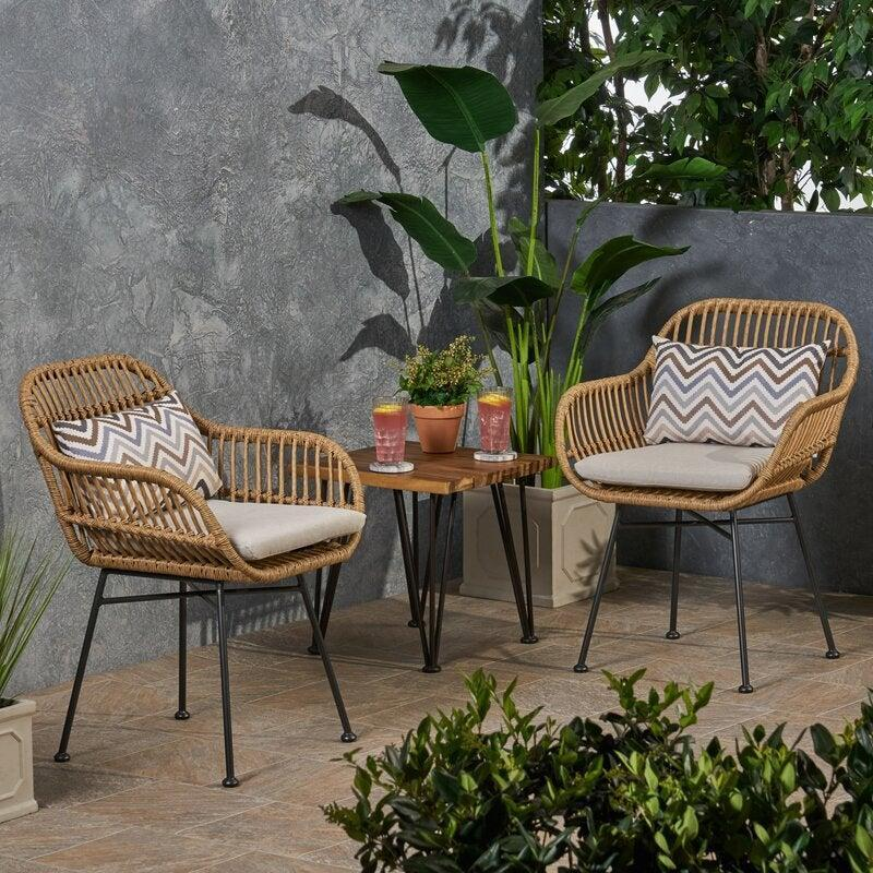 """<br><br><strong>George Oliver</strong> Enger Outdoor Woven Patio Chair with Cushion (Set of 2), $, available at <a href=""""https://go.skimresources.com/?id=30283X879131&url=https%3A%2F%2Fwww.wayfair.com%2Foutdoor%2Fpdp%2Fgeorge-oliver-enger-outdoor-woven-patio-chair-with-cushion-w001617888.html%3Fpiid%3D928495637"""" rel=""""nofollow noopener"""" target=""""_blank"""" data-ylk=""""slk:Wayfair"""" class=""""link rapid-noclick-resp"""">Wayfair</a>"""