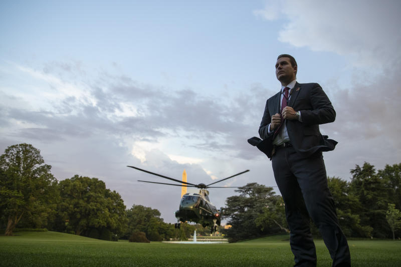 As a U.S. Secret Service Special Agent stands ready, Marine One, with President Donald Trump aboard, approaches for landing on the South Lawn of the White House, Thursday, June 25, 2020, in Washington. Trump is returning from Wisconsin. (AP Photo/Alex Brandon)