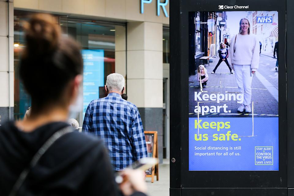 A woman looks at the UK government's digital advert in London which highlights 'Keeping apart, Keep safe' during the COVID19. The number of people who tested positive for the coronavirus is increasing. (Photo by Dinendra Haria / SOPA Images/Sipa USA)