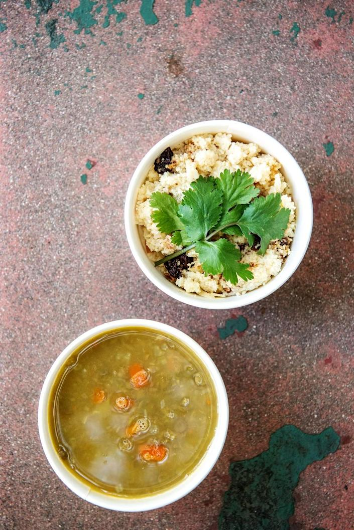 Couscous with fruit and nuts alongside a bowl of lentil and fennel soup.