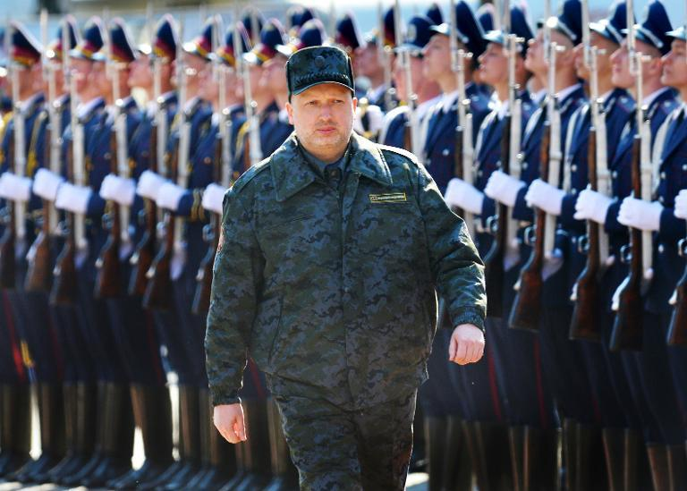 Olexander Turchynov, speaker of the parliament and interim Ukrainian president, reviews the troops of the newly founded National Guard prior to military exercises on the shooting range, near Kiev on March 31, 2014