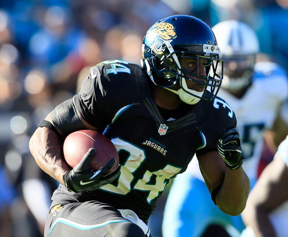 JACKSONVILLE, FL - NOVEMBER 25:   Jalen Parmele #34 of the Jacksonville Jaguars rushes for yardage during the game against the Tennessee Titans at EverBank Field on November 25, 2012 in Jacksonville, Florida.  (Photo by Sam Greenwood/Getty Images)